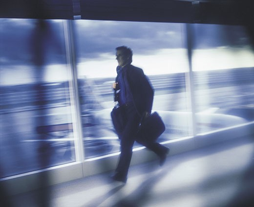 Businessman rushing to catch plane : Stock Photo