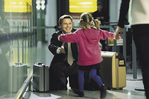 Stock Photo: 1598R-210486 Businessman greeting child at airport