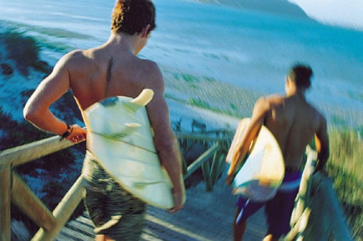 Two surfers headed down to beach : Stock Photo