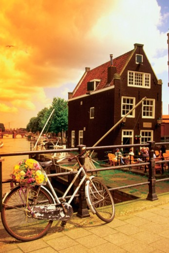 Bicycle with a bouquet of flowers on a bridge, Amsterdam, Holland : Stock Photo