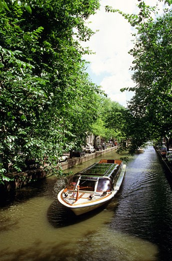 High angle view of an empty boat in a canal, Amsterdam, Netherlands : Stock Photo