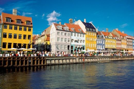 Stock Photo: 1598R-213298 Tourists at a sidewalk cafe, Nyhavn Canal, Copenhagen, Denmark