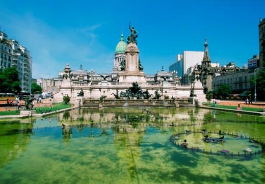 Stock Photo: 1598R-213340 Reflection of a building in a fountain, Plaza del Congreso, Congress Square, Buenos Aires, Argentina