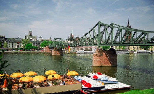 Bridge over the Main River with floating cafe, Frankfurt, Germany : Stock Photo