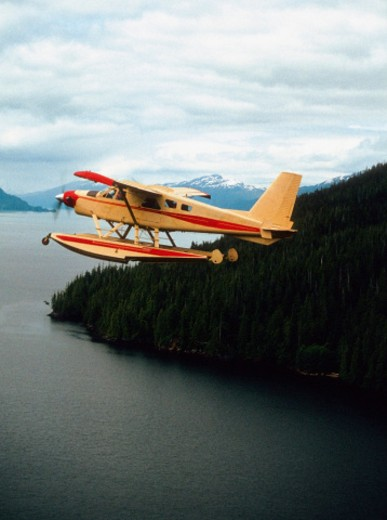 Seaplane flying near Ketchikan, Alaska, USA : Stock Photo