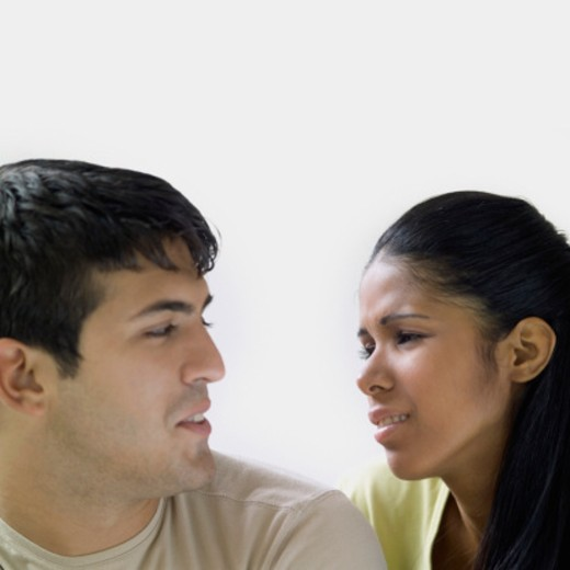 Young couple looking at each other, close-up : Stock Photo