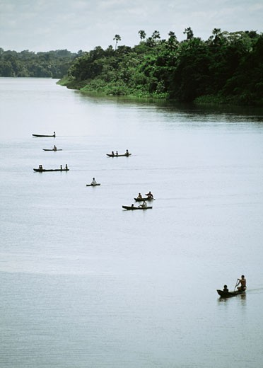 Stock Photo: 1598R-213918 Group of people canoeing on Breves Narrows on the Amazon River, Brazil
