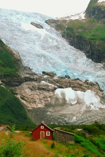 High angle view of a red house near a glacier, Jostedalsbreen Glacier, Voss, Hordaland, Norway : Stock Photo