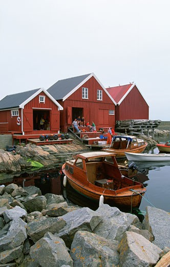 Boats in water near the houses, Grip Island, Norway : Stock Photo