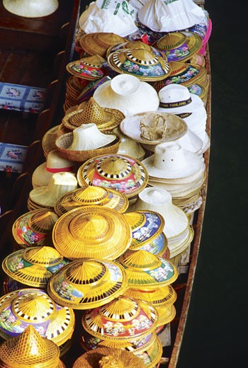 High angle view of hats on a boat, Damnoen Saduak Floating Market, Bangkok, Thailand : Stock Photo