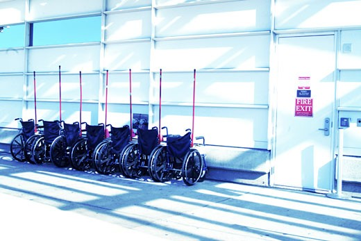 Wheelchairs in a row in an airport : Stock Photo