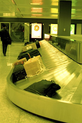 Luggage on baggage claim in an airport : Stock Photo