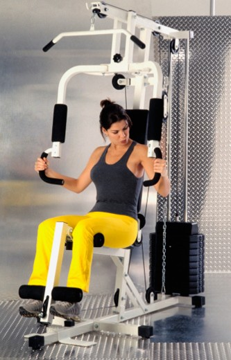Woman doing workout in gym : Stock Photo