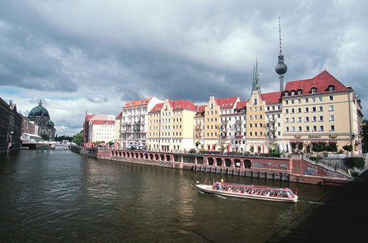 Tour boat on the Spree Canal in front of St. Nicholas Quarter, Berlin, Germany : Stock Photo