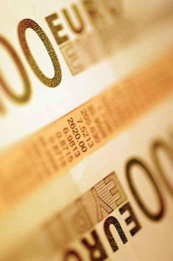 Stock Photo: 1598R-217027 European currency: euro bank notes on top of stock market report