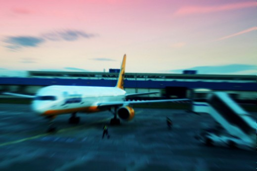 Airplane landing on a runway : Stock Photo
