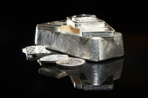 Silver bars and coins : Stock Photo
