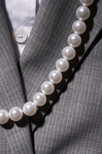 Stock Photo: 1598R-224021 Woman's pinstripe suit jacket, button down shirt and pearl necklace