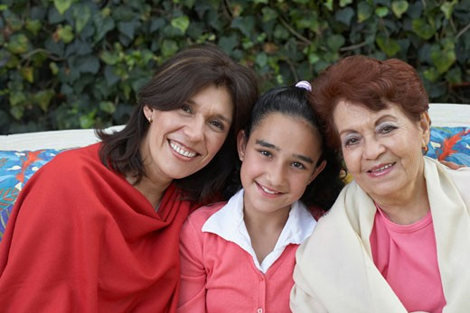 Portrait of a senior woman with her daughter and granddaughter : Stock Photo