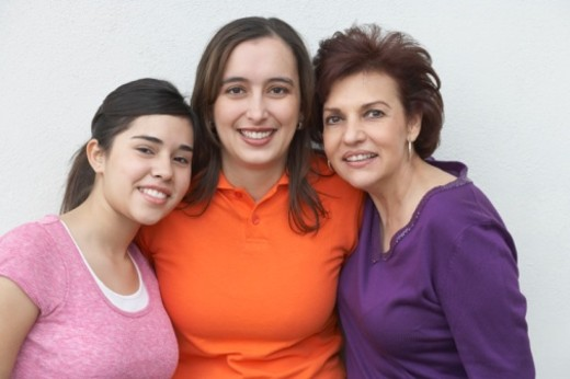 Portrait of a mature woman with her mother and daughter : Stock Photo