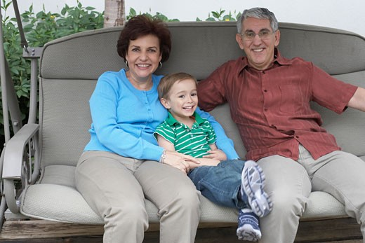 Portrait of a senior couple with their grandson : Stock Photo