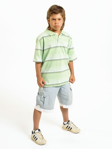 Boy (10-11) standing with legs apart, portrait : Stock Photo