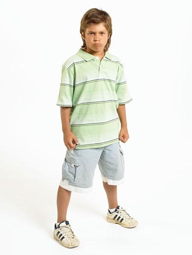 Stock Photo: 1598R-224889 Boy (10-11) standing with legs apart, portrait