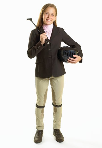 Teenage girl (16-17) wearing equestrian outfit, smiling, portrait : Stock Photo