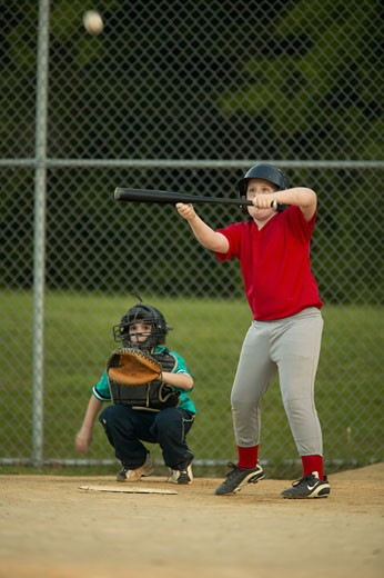 Baseball youth league batter (14-15) bunting : Stock Photo