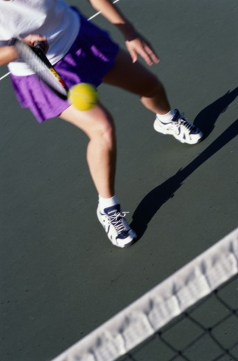 Stock Photo: 1598R-227873 Tennis Player Advancing to the Net