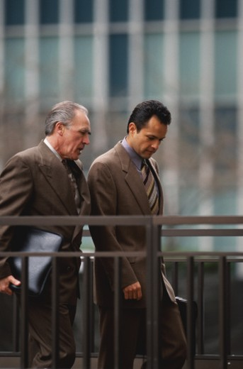 Businessmen Walking and Talking : Stock Photo
