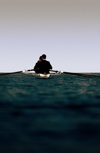 Businesspeople Rowing : Stock Photo