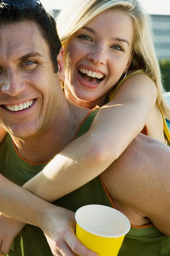 Stock Photo: 1598R-233969 Woman hugging man at tailgate party