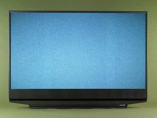 Flat screen television displaying static, front view. : Stock Photo
