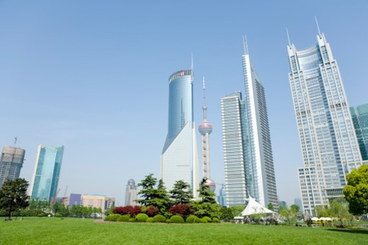 China, Shanghai, skyscrapers in Pudong Business District seen from park : Stock Photo