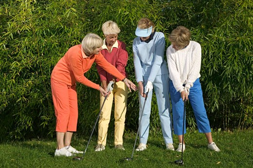 Stock Photo: 1598R-235445 Mature and senior women learning to play golf