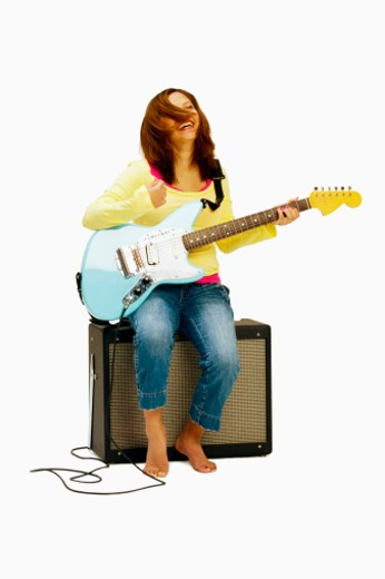 Stock Photo: 1598R-236080 Teenage girl (14-15) sitting with guitar, smiling