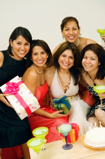 Mid adult women at birthday party, smiling, portrait : Stock Photo