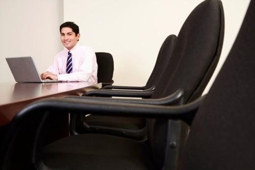 Stock Photo: 1598R-236728 Businessman smiling, using laptop