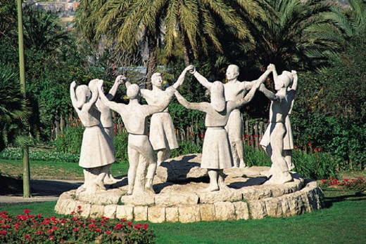 Stock Photo: 1598R-236975 Sculpture of people holding raised hands