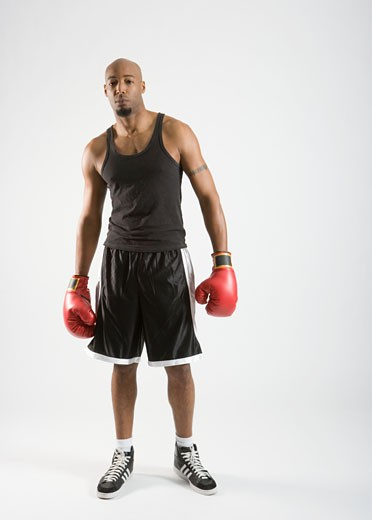 Stock Photo: 1598R-237200 Boxer wearing red boxing gloves, portrait