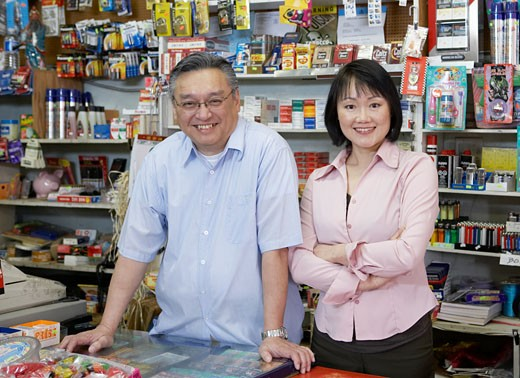 Shop owner and wife, behind shop counter, portrait : Stock Photo