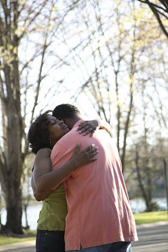 Stock Photo: 1598R-240677 Mature couple embracing in park