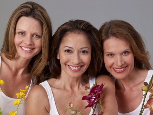Stock Photo: 1598R-240771 Three mature women, holding flowers, smiling, portrait