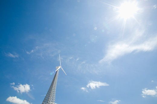 Stock Photo: 1598R-240883 Wind turbine against blue sky, low angle view