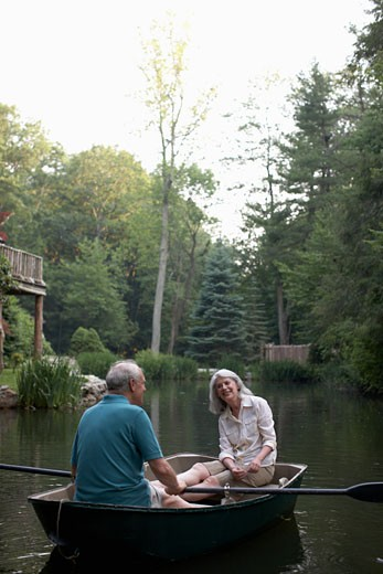 Senior couple in boat on lake : Stock Photo
