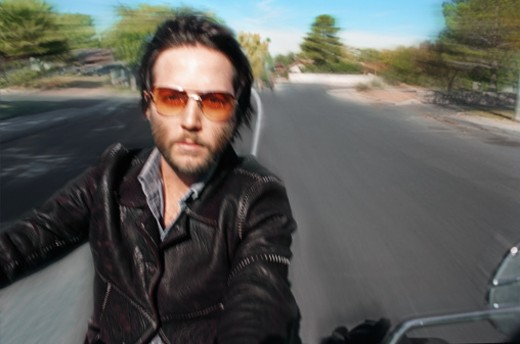 Young man on motorbike, blurred motion : Stock Photo
