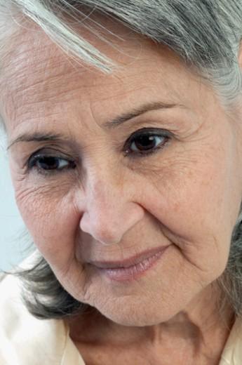 Close-up of sad senior woman : Stock Photo