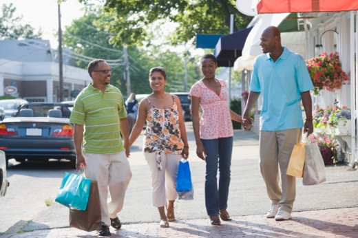 Stock Photo: 1598R-243180 Mature couple and a mid adult couple carrying shopping bags