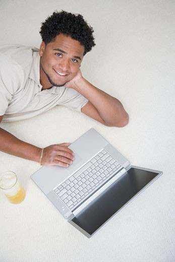 Stock Photo: 1598R-243320 High angle view of a young man using a laptop